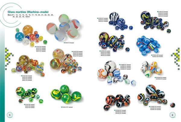 Twisted machine-made glass marbles