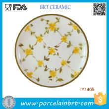 Élégant petit plat en céramique de fleurs jaunes