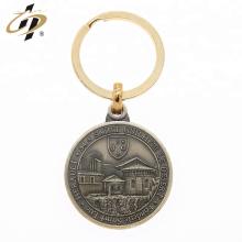 O metal 3d redondo feito sob encomenda possui o keychain do símbolo da moeda do projeto