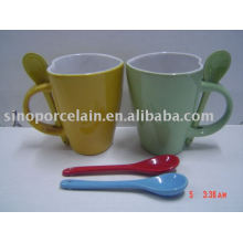 Heart shaped ceramic mug with spoon