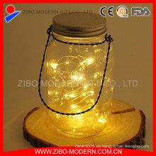 Colgante de almacenamiento de vidrio de decoración de vidrio Mason con LED de luz solar cubierta de metal