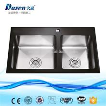 L'eau de la main en verre trempé double bol cuisine rince les lavabos avec le robinet