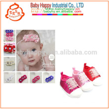 Girls toddler sport shoes and beautiful flowers of baby shoes