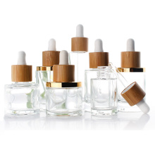 clear 15ml 30ml 50ml round essential oil cosmetic glass dropper bottles with bamboo lid