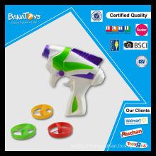 Engraçado jogos infantis UFO arma de brinquedo com vento até brinquedo pires voadores