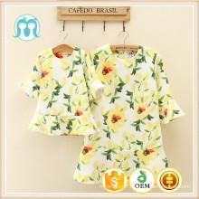 Tissu de robe de coton et de polyester Mesdames china robe conceptions floral jaune sweetty robes prix d'usine pour les femmes et les enfants
