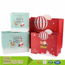 Guangzhou-Fabrik-Preis Eco-freundliches anwesendes extravagantes Papier, welches die kleine Weihnachtstasche für Geschenk verpackt