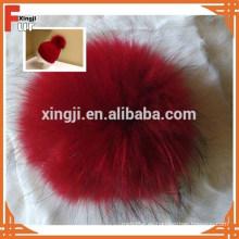 China proveedor pompones de piel de mapache