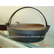 cast iron wok with wood lid