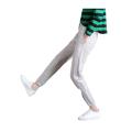 Pantalon de sport élégant en coton à rayures latérales pour femmes