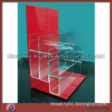Trilaminar crystal acrylic magazine holder with red backdrop