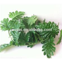 Lifelike Evergreen plástico grossista artificial folhas