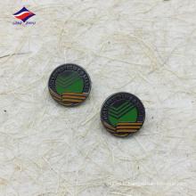 Insigne rond en métal noir plaqué noir avec logo
