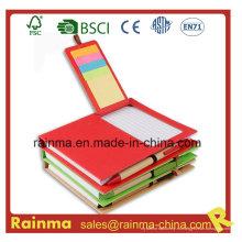 Cuaderno de papel con bloc de notas pegajoso y lápiz