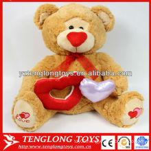Stuffed brown bear for valentines day gifts holding a heart