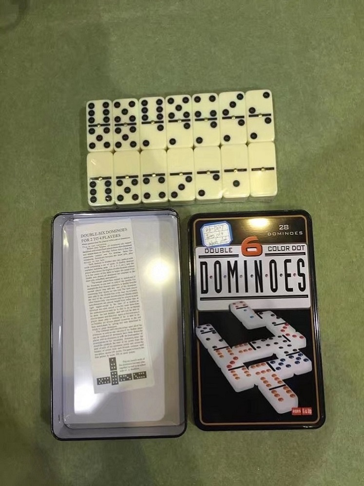 ivory color black dots and spin in tin box