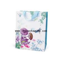 Hochwertiger Kunst-Papiertüte mit geklebtem Band auf der Oberseite