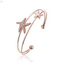 Bracelet en or rose de manchette d'étoile de mer d'or rose mignon