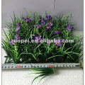 Artificial grass carpet with flowers