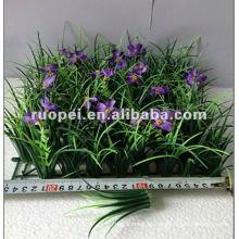 Alfombra de césped artificial con flores
