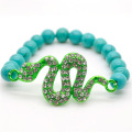 Turquoise 8MM Round Beads Stretch Gemstone Bracelet with Diamante Snake Piece