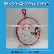 Porte-pot en céramique avec forme papillon