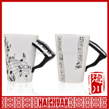 mug with embossed musical instrument handle