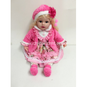 "22"" pink coat and blond hair doll"