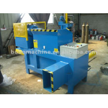 WOODEN SHAVINGS COMPRESSING AND BAGGING MACHINE
