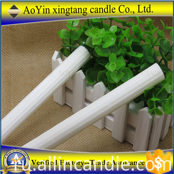 white candle wih plastic bag
