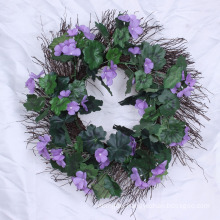Artificial evergreen wreaths with Flower