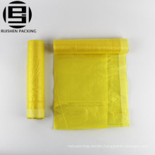 Perforated drawstring plastic trash garbage bag
