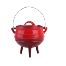 round cast iron enamel potjie pot with three-leggs for dish prepared outdoors