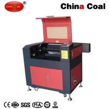 Machine commerciale de gravure de laser de commande numérique par ordinateur de Zm9060dp + CO2