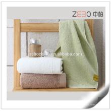 Personalizado cor lisa tecida toalha de algodão comprimido por atacado pacote