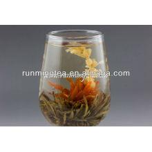 Blühende Tee-Glas-Teekanne