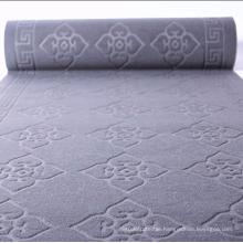 Soft velour embossed dust resistant floor mat
