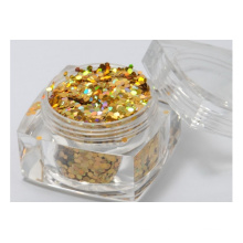 cosmetic glitter powder in dark gold