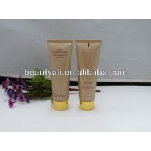 Cosmetic packaging tube with alumite cap