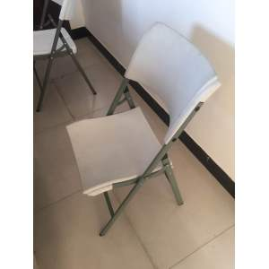 Folding plastic white chairs