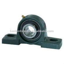 housing with pillow block bearing