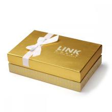 Caja de papel dorada a medida para ropa de alta gama