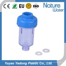 Um filtro de água claro da máquina de lavar da fase