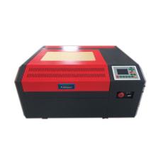 Low price co2 laser engraving machine phone case engraving machine 4040