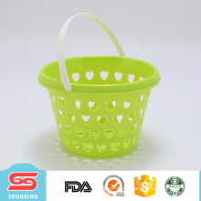 Household portable mini circular plastic fruit basket with hollow design