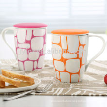 tomacorrientes de fábrica al por mayor tazas de cerámica con filtro y tapa de silicona