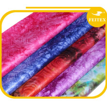 Alibaba china diferentes tipos de tela africana Guinea brocado bazin mujeres usan garmens para la fiesta de bodas