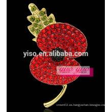 Flor roja y broche de hoja verde