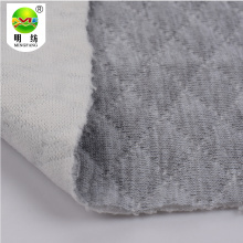 Wholesale polyester knitted jacquard stocklot fabric