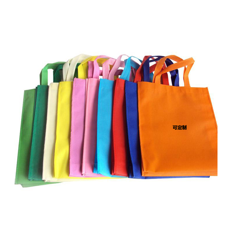 Custom hand-held nonwoven bag